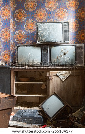 old antique television broken grunge televisions broken en full of dust end of TV - stock photo