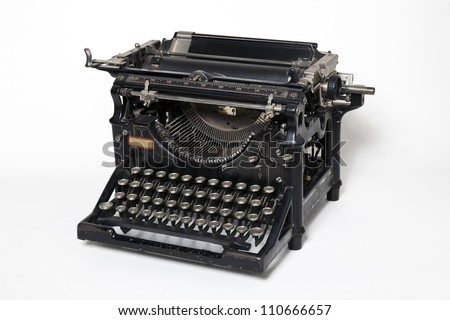 Old antique typewriter on a white background - stock photo