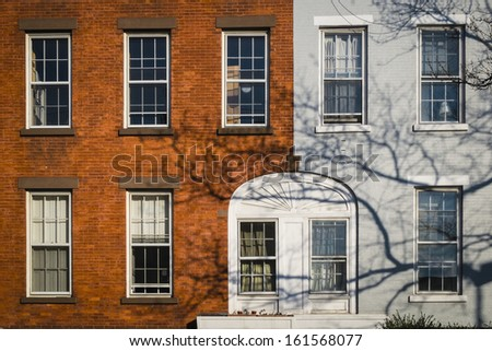Old apartment building and tree branches, New York City - stock photo