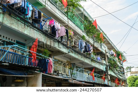 Old apartment building decorated by Vietnam National flags in the very first day of New Year 2015, Saigon, Vietnam - stock photo