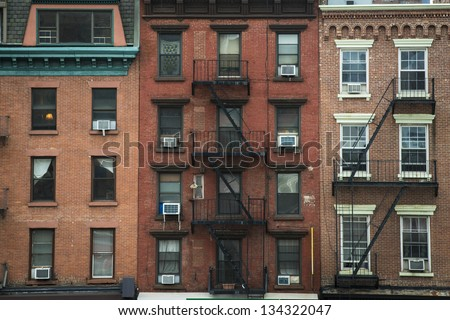 Old apartment buildings and fire escapes, New York City - stock photo