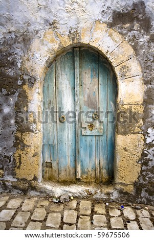 Old arched door in North Africa - stock photo