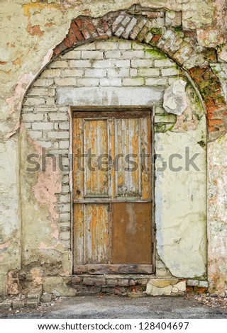Old architectural details - door and arched entrance - stock photo