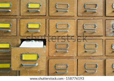 Old archive with wooden drawers - stock photo