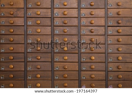 Old archive  wooden drawers - stock photo