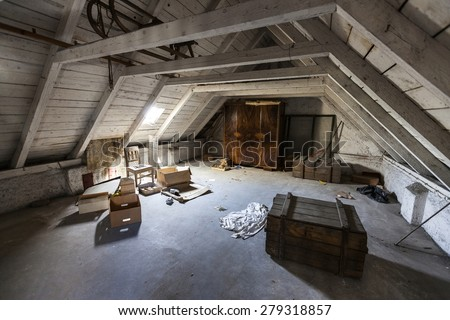 Old attic with hidden secrets of an abandoned house - stock photo