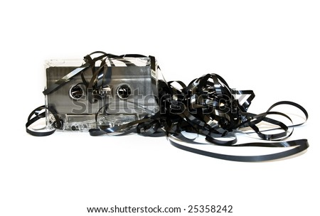 Old audio cassette with unwound tape on white - stock photo