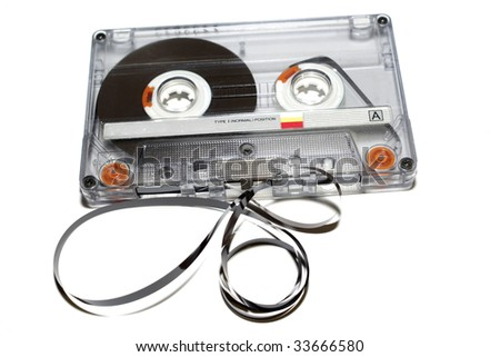 old audio tape on white background - stock photo