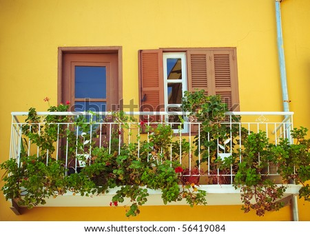 old balcony with flowers - stock photo