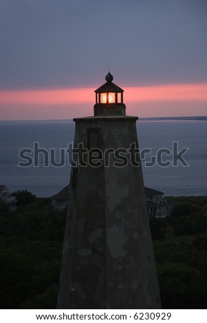 Old Baldy lighthouse at dusk on Bald Head Island, North Carolina. - stock photo