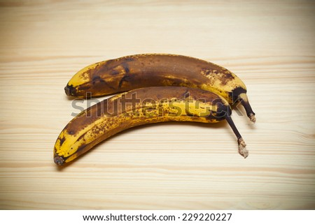 Old banana on wooden board  - stock photo