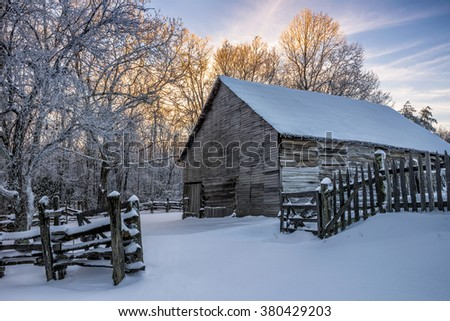 Old barn and fresh snow at the Cumberland Gap National Park - stock photo
