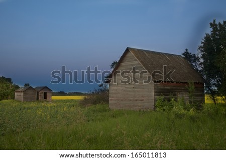 old barn in prairie province at dusk - stock photo