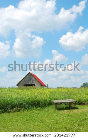 old barn on field - stock photo