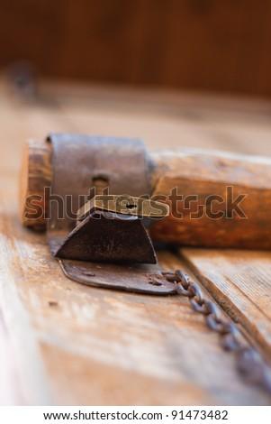 Old barn padlock - stock photo