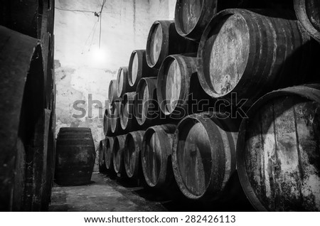 Old barrels for Whisky or wine in winere in black and white - stock photo