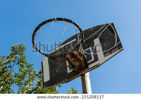 Old Basketball hoop and blue sky background - stock photo