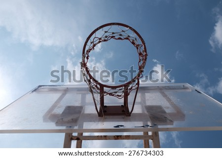 old basketball hoop on an out door court - stock photo