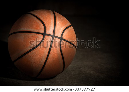 Old basketball on dark background - stock photo