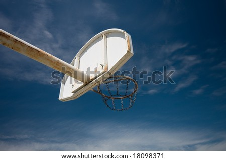 old basketball ring against blue sky - stock photo