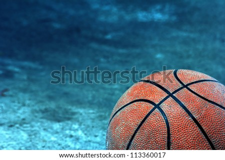 Old basketball. Screw on the dark background. - stock photo