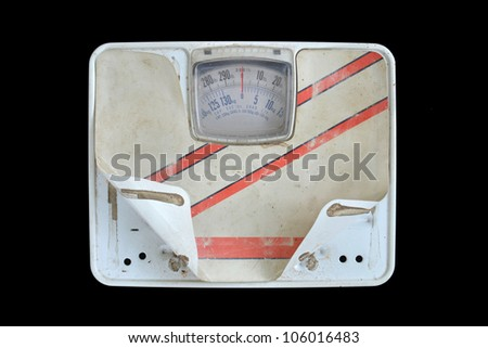 old bathroom scale on black background - stock photo