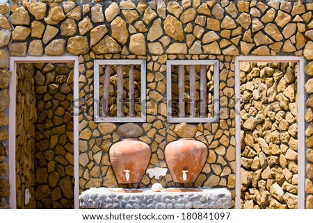 Old bathroom with double basin outdoor - stock photo