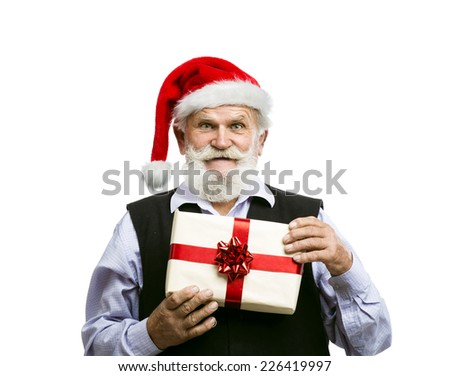 Old bearded man in santa hat holding Christmas gift isolated on white background - stock photo