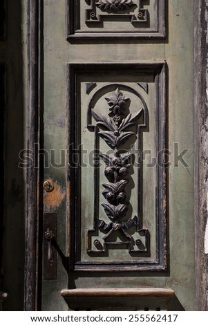 Old beautiful carved wooden doors - stock photo