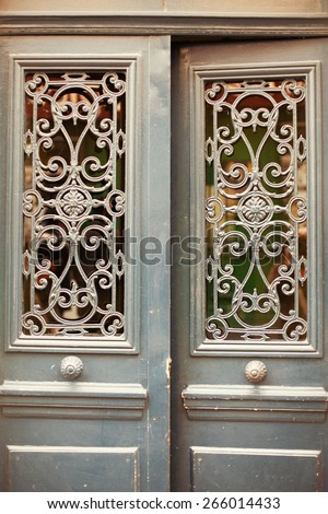 Old beautiful doors in Paris - stock photo