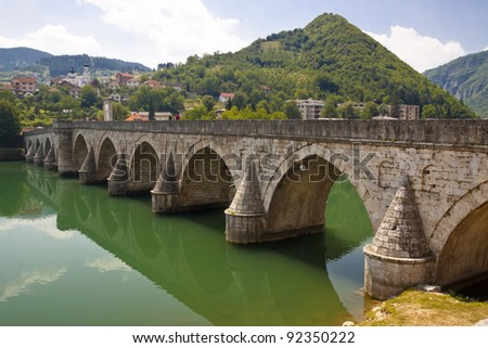 Old beauty bridge on Drina river in Visegrad town - Bosnia and Herzegovina. - stock photo