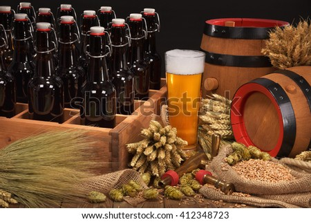 old beer crate with beer glass, hops, wheat, grain, barley and malt - stock photo