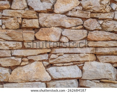 Old beige stone wall background, texture - stock photo