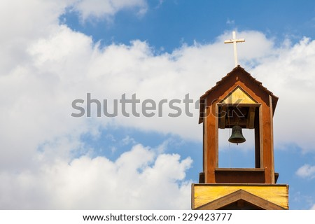 Old bell on the top of a Christian church in south of Spain. - stock photo