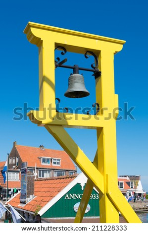 Old bell pole in volendam, netherlands. Traditionally this is the place where young couples got their notice of marriage. - stock photo
