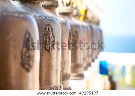 Old bells in a buddhist temple of Thailand - stock photo