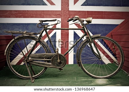 Old Bicycle against  brick Wall - stock photo