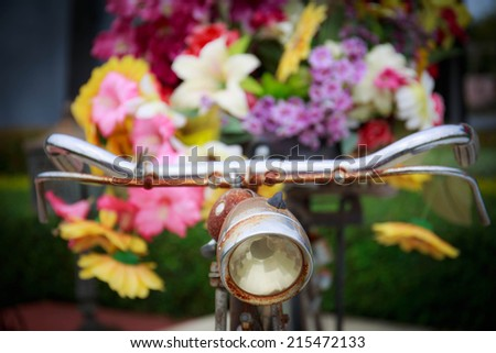 Old bicycle and flowers. - stock photo