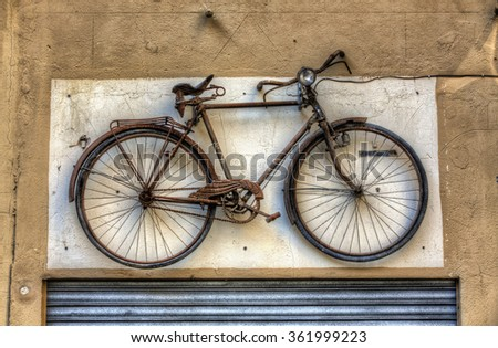 Old Bicycle Decorating a Facade in the Old City, Palma, Mallorca - stock photo