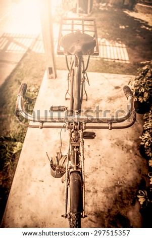 Old bicycle in vintage color tone - stock photo