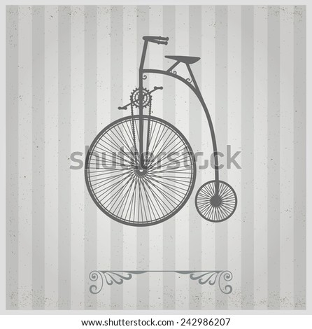 Old bicycle on a gray background - stock photo