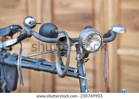 old bicycle on wood background - stock photo