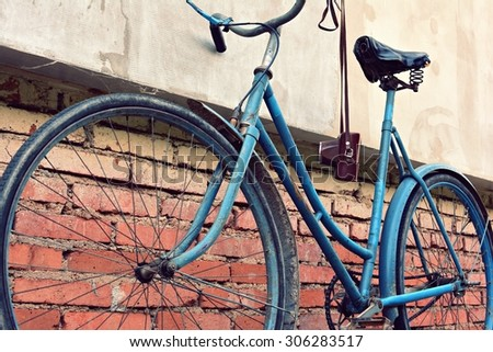 Old bicycle with a retro effect - stock photo