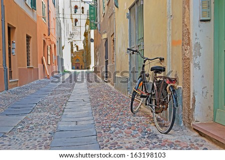 old bike on the edge of an old street - stock photo