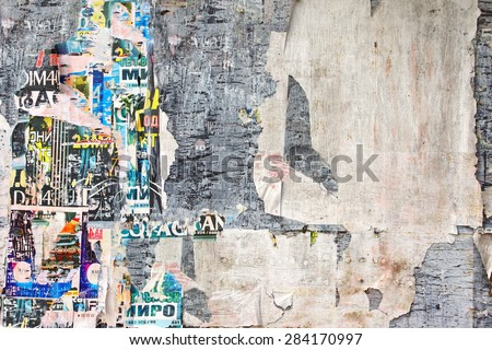 Old Billboard with Torn Posters. Vintage Background and Texture for text or image - stock photo