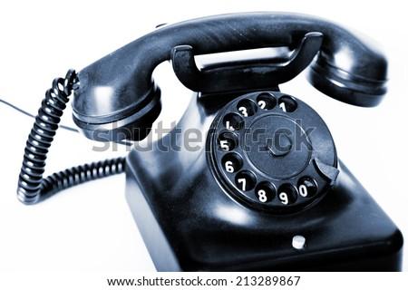 Old black desk phone - stock photo