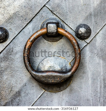 Old black metal door in temple gate with ring knocker  - stock photo
