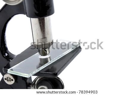 Old black microscope - stock photo