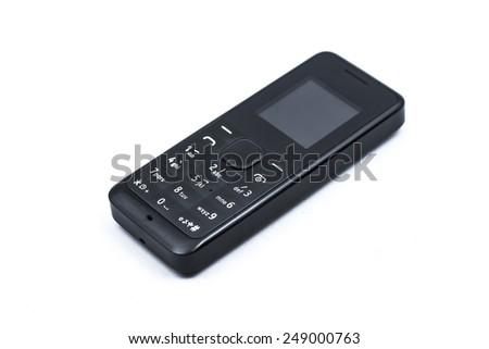 Old black mobile phone with keypad on white background - stock photo