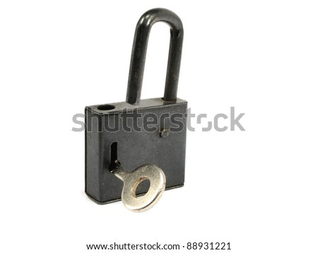 old black padlock with key on a white background - stock photo
